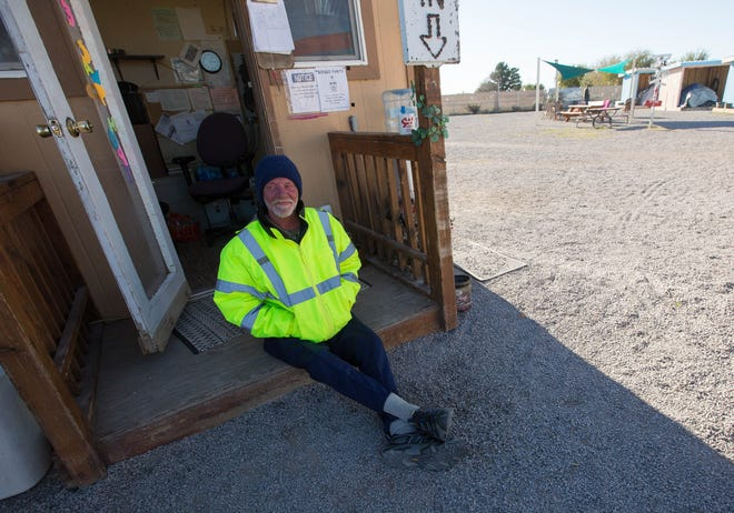 Alan Abrams sits at the gate of Camp Hope, taking a shift on the gate for a friend who could not work, Tuesday November 13, 2018. With a cold snap Monday night into early Tuesday, residents of Camp Hope can always use more donations of warm clothes and blankets, which can be dropped off at the Community of Hope office during business hours or at Camp Hope directly after hours.