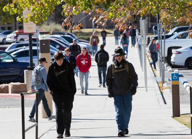 The NMSU Board of Regents OK'd a 6 percent hike in tuition and fees for students on the main campus starting in the fall of 2019. Students are seen walking the campus in this November 2018 file photo.