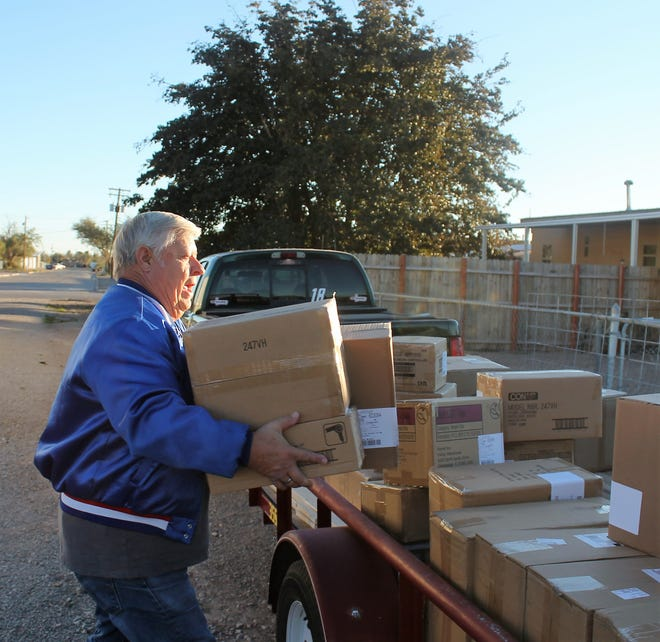 Alamogordo Toys for Tots organizer Wally Anderson unloads his first truck-full of toys from the Toys for Tots Foundation on Nov. 13. Toys came from Hasbro and Rhode Island Novelty and included puzzles, Star Wars kits and other kinds of toys. There were about 400 toys in the delivery.