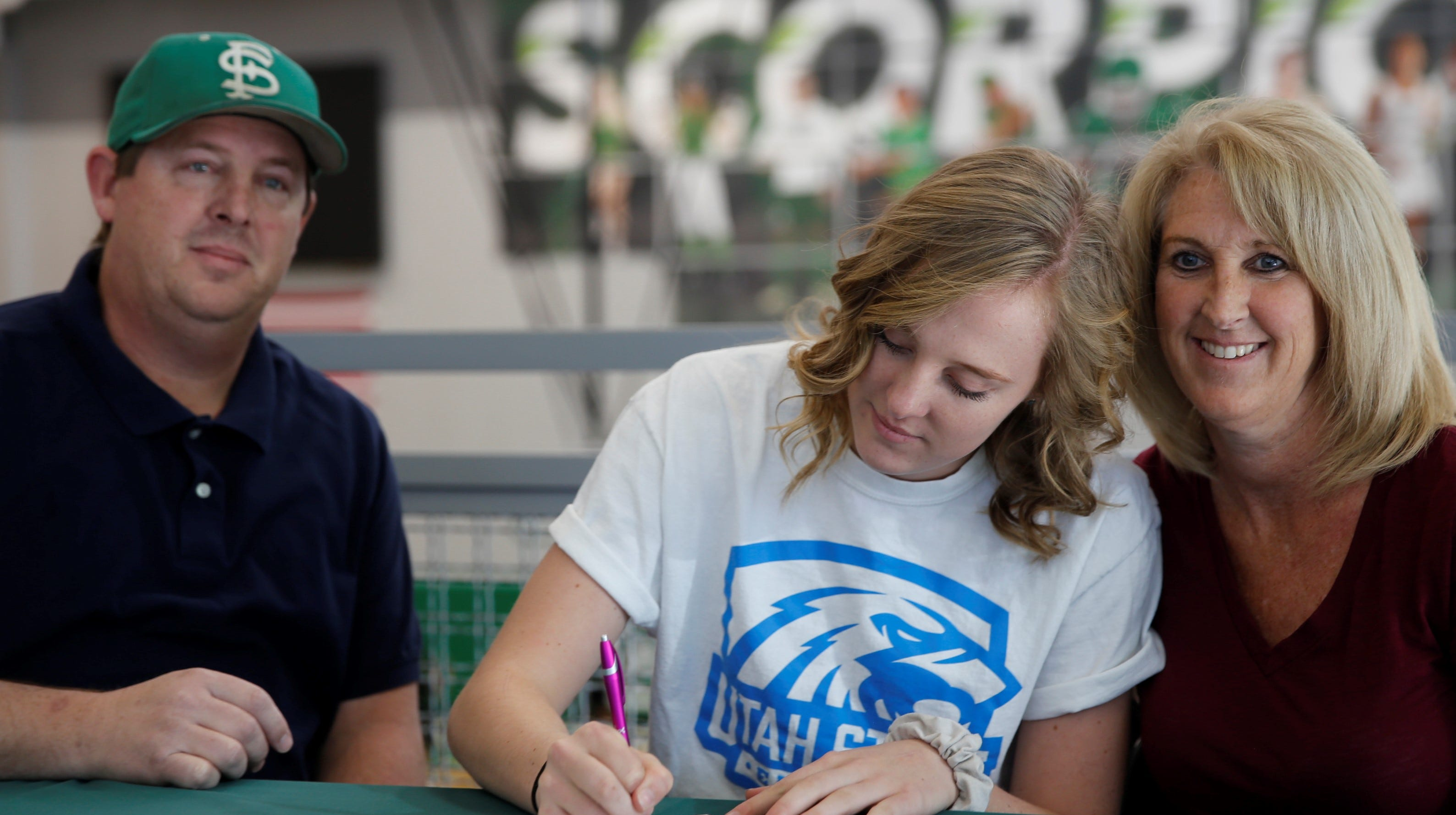 Farmington's Alyssa Simmons signs her letter of intent on Tuesday to continue her volleyball career at Utah State University Eastern.