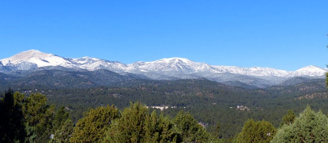 The Sacramento Mountain Range above Ruidoso was covered in snow Tuesday morning after a storm passed through a day earlier, dropping temperatures. The range includes Sierra Blanca Peak and the Ski Apache Resort.