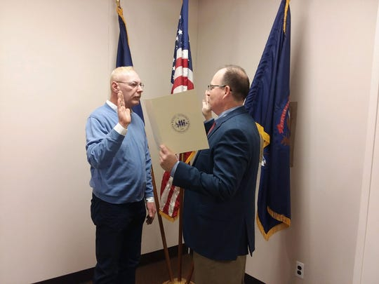 Anthony Miller, left, is sworn into office by Wayne City Clerk Matthew Miller, right, Nov. 13 in Wayne City Hall. Anthony Miller won election to the Wayne Council in the Nov. 6 election.