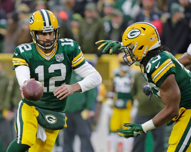Green Bay Packers quarterback Aaron Rodgers (12) hands the ball to running back Aaron Jones (33) against the Miami Dolphins at Lambeau Field on Sunday, November 11, 2018 in Green Bay, Wis.Adam Wesley/USA TODAY NETWORK-Wisconsin