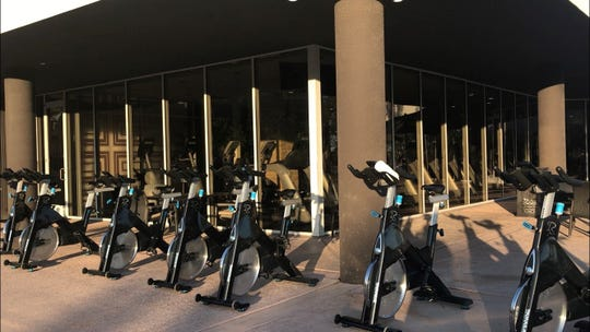 Exercise bikes both inside and outside of the fitness center at PGA West are part of the new sports complex.