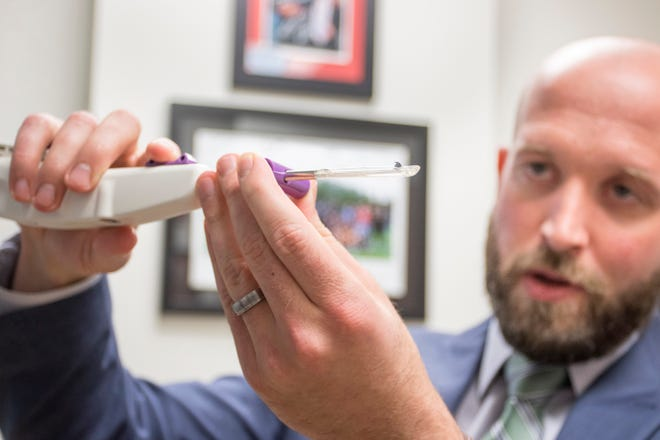 Dr. Brett Kindle demonstrates how the new minimally invasive Sonex MicroKnife is used to perform a carpal tunnel release procedure at the Andrews Institute in Pensacola on Friday, November 9, 2018.