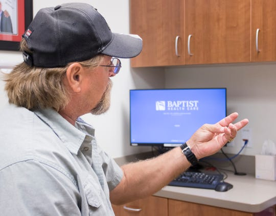 Bill Armstrong demonstrates the dexterity in his left hand after the new minimally invasive carpal tunnel release procedure performed by Dr. Brett Kindle at the Andrews Institute in Pensacola on Friday, November 9, 2018.
