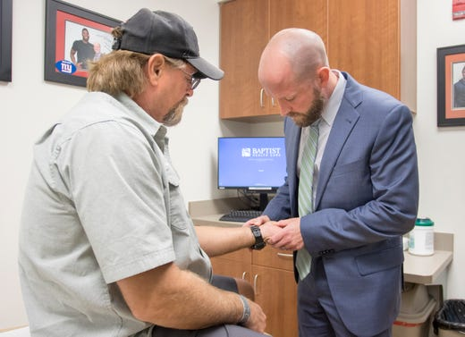 Dr. Brett Kindle does a follow up exam on Bill Armstrong after his minimally invasive carpal tunnel release procedure at the Andrews Institute in Pensacola on Friday, November 9, 2018.