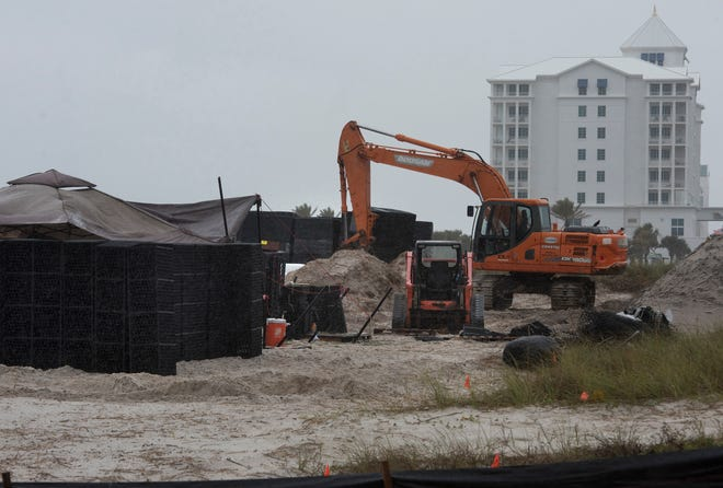 Work on a new parking lot at Casino Beach behind the Escambia County Sheriff's Office substation is underway on Tuesday, Nov. 13, 2018.