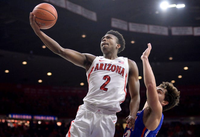 Nov 7, 2018: Arizona Wildcats guard Brandon Williams (2) shoots the ball as Houston Baptist Huskies guard Oliver Lynch-Daniels (23) defends during the first half at McKale Center.