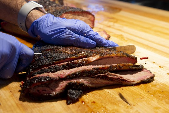 Chef/owner Scott Holmes is getting ready to open his second Little Miss BBQ in north Phoenix. Holmes slices some brisket.