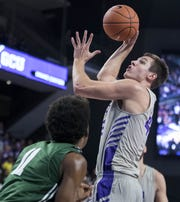 Grand Canyon University's Gerard Martin looks to the basket against Jacksonville's Jalyn Hinton the second half of their game in Phoenix, Monday, Nov.11,  2018.