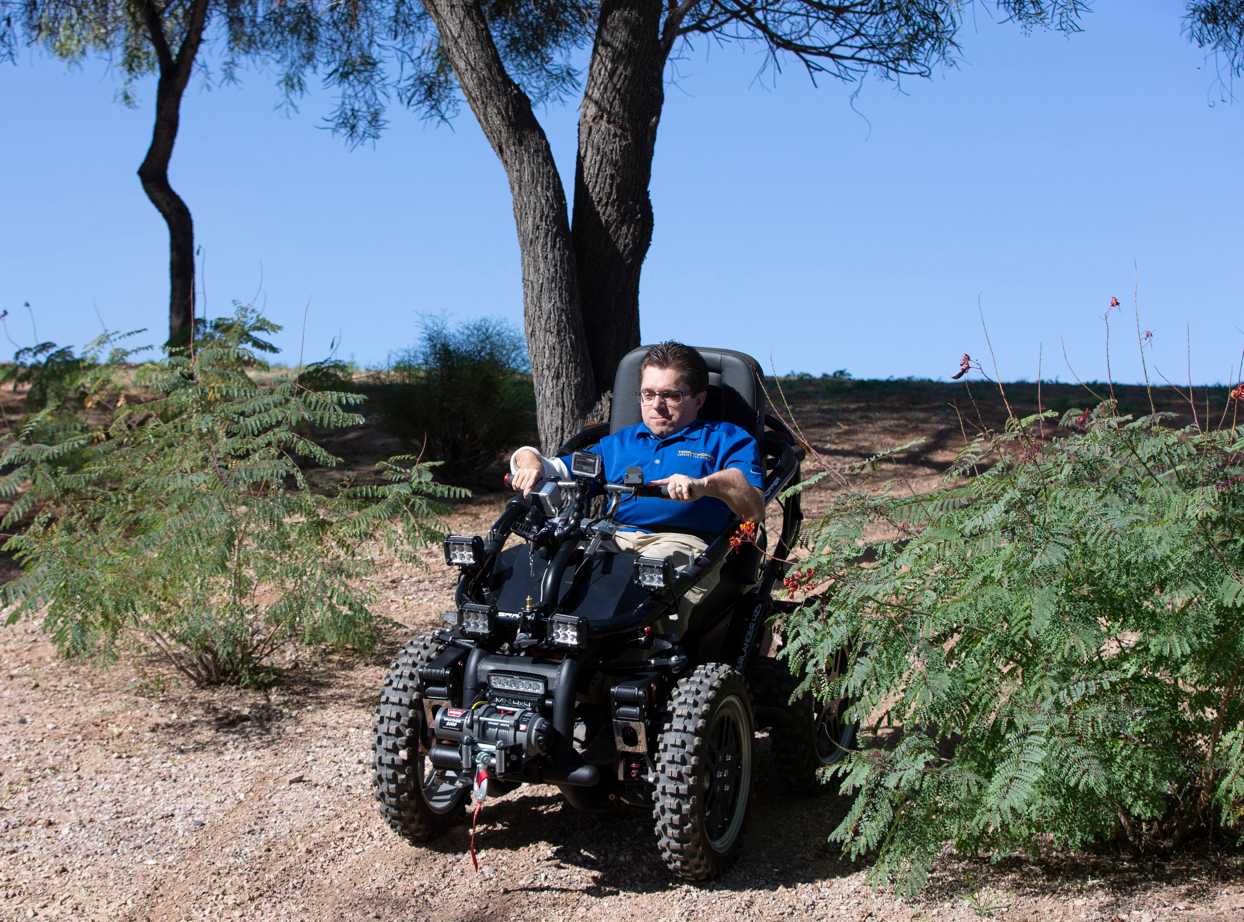 Todd Lemay, owner of TerrainHopper USA in Tempe, demonstrates how the all-terrain vehicle works. Cost starts at $18,000 and go up depending on options like controls, extended-life batteries, USB ports and, of course, cup holders.