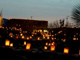Workers at Desert Botanical Garden light and snuff out 8,000 luminarias nightly and devices using butane torches and turkey basters make it easier.