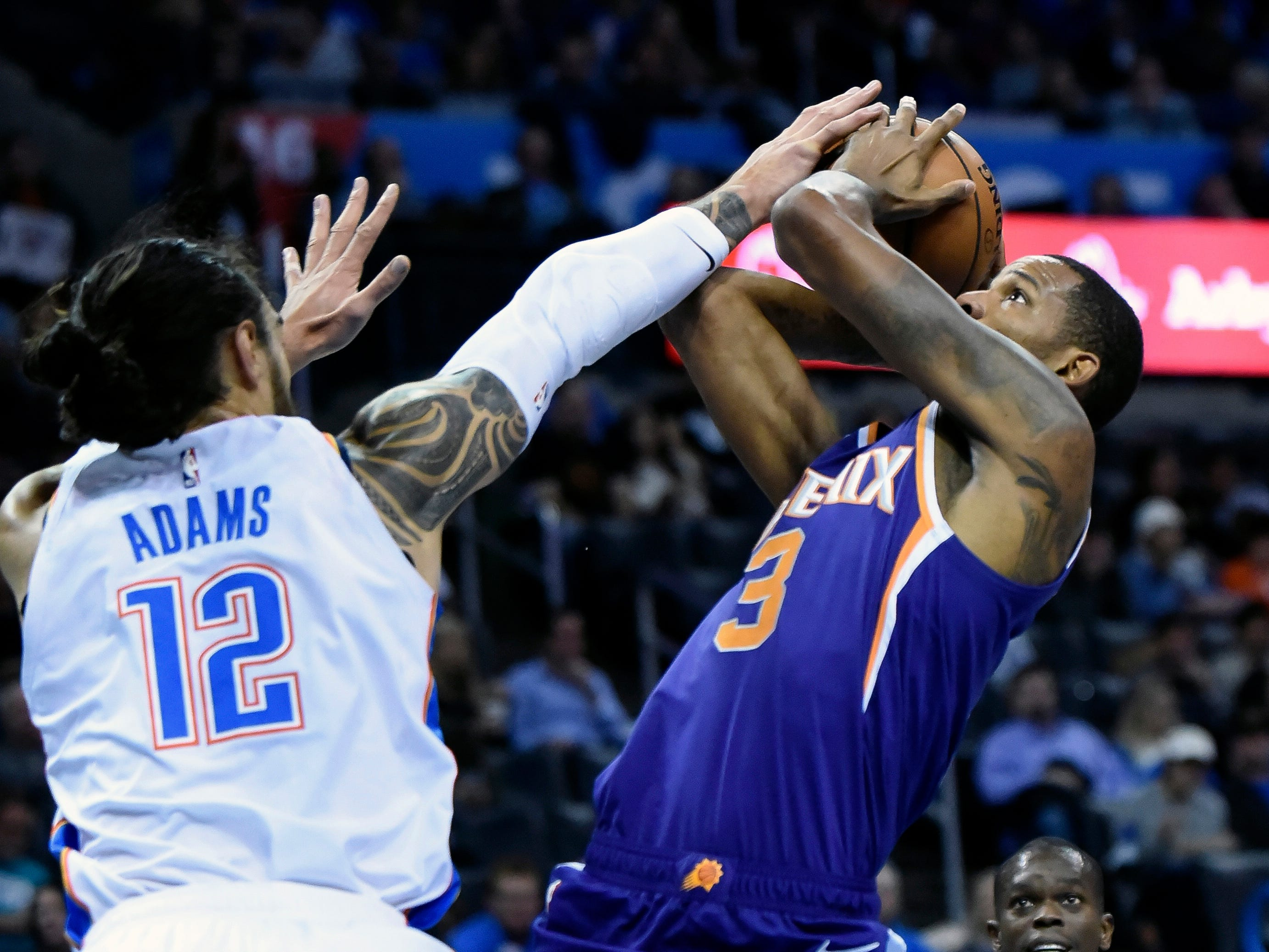Oklahoma City Thunder center Steven Adams (12) blocks a shot by Phoenix Suns forward Trevor Ariza (3) in the first half of an NBA basketball game in Oklahoma City, Monday, Nov. 12, 2018. (AP Photo/Kyle Phillips)