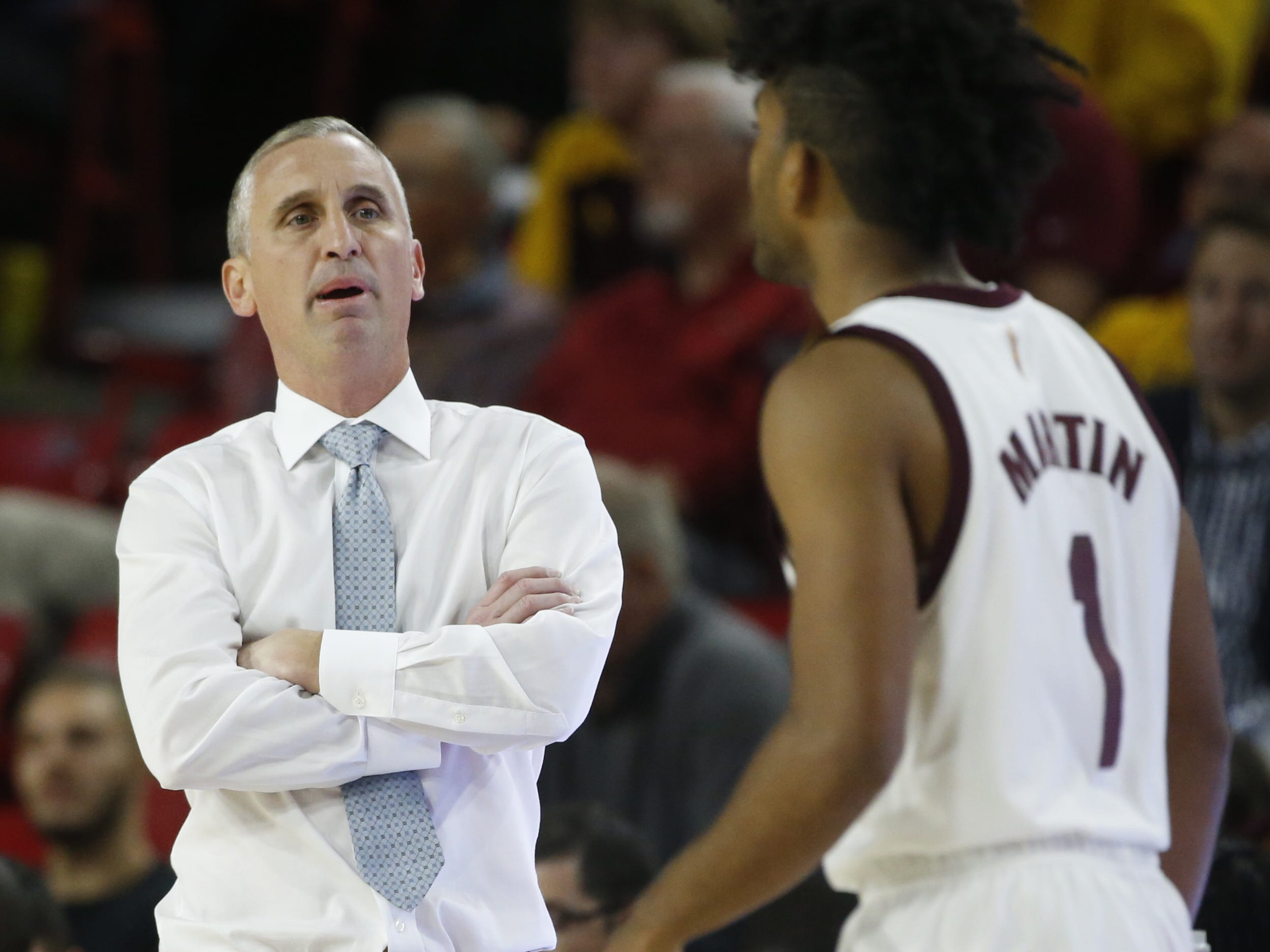 Arizona State head coach Bobby Hurley talks with Remy Martin as he enters the game during the first half against Long Beach State at Wells Fargo Arena in Tempe, Ariz. on November 12, 2018.