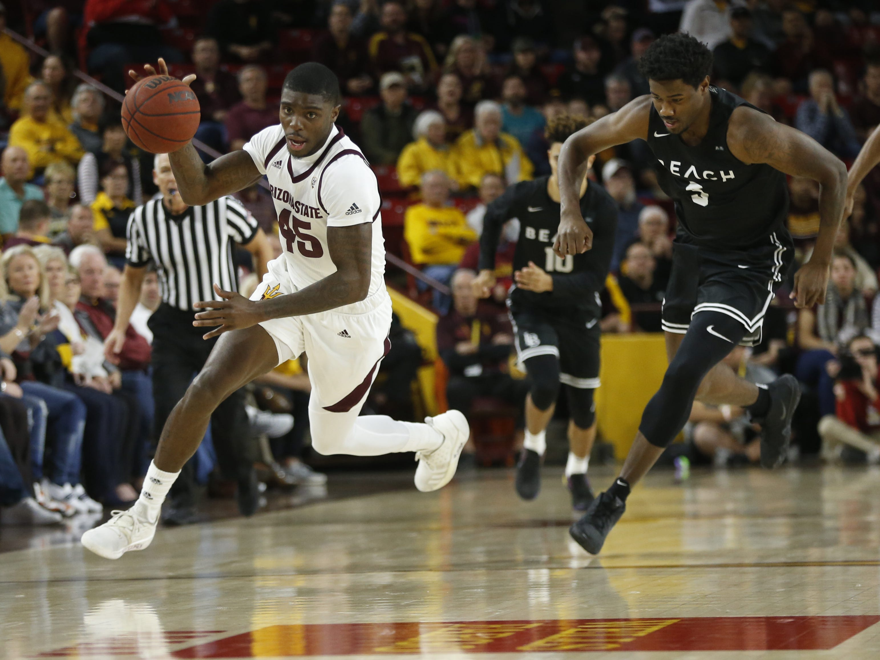 Arizona State's Zylan Cheatham (45) runs past Long Beach State's Mason Riggins (5) after a steal during the first half at Wells Fargo Arena in Tempe, Ariz. on November 12, 2018.