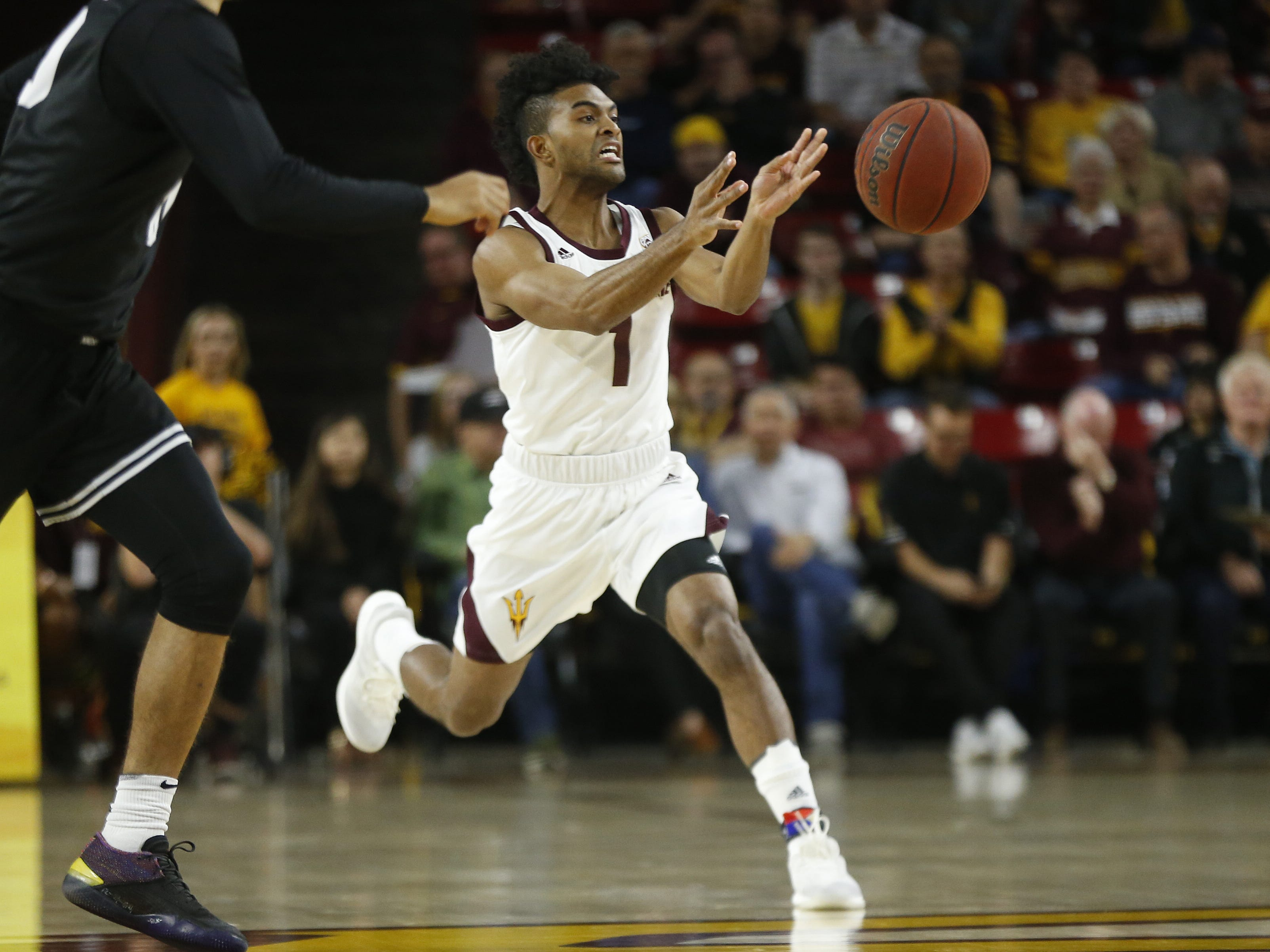 Arizona State's Remy Martin (1) passes the ball to a teammate against Long Beach State during the first half at Wells Fargo Arena in Tempe, Ariz. on November 12, 2018.