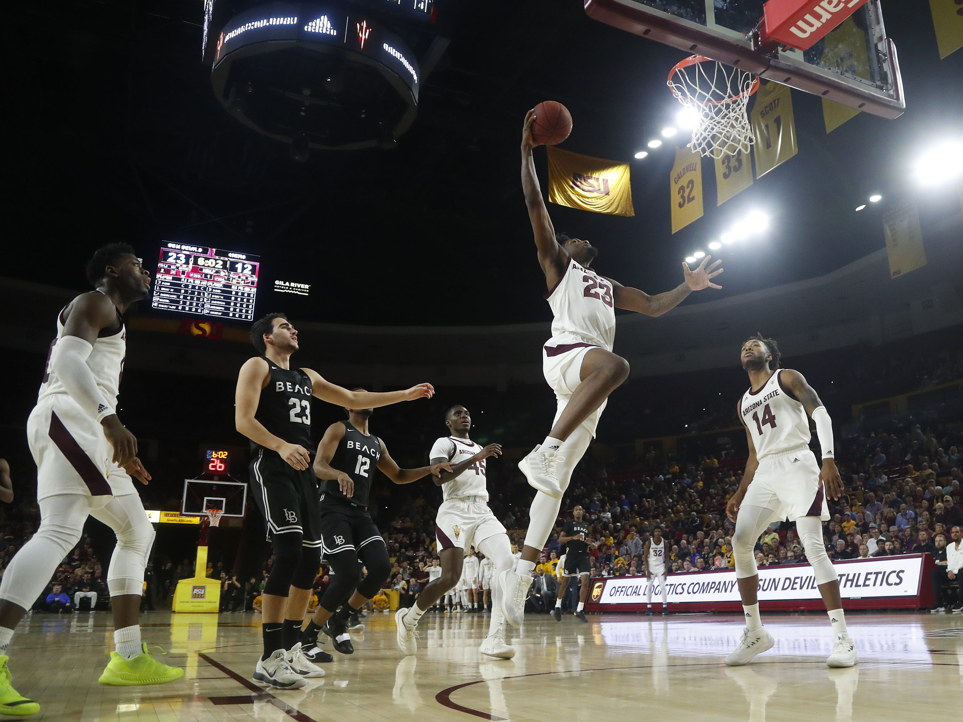 Arizona State's Romelo White (23) drunks the ball against Long Beach State during the first half at Wells Fargo Arena in Tempe, Ariz. on November 12, 2018.