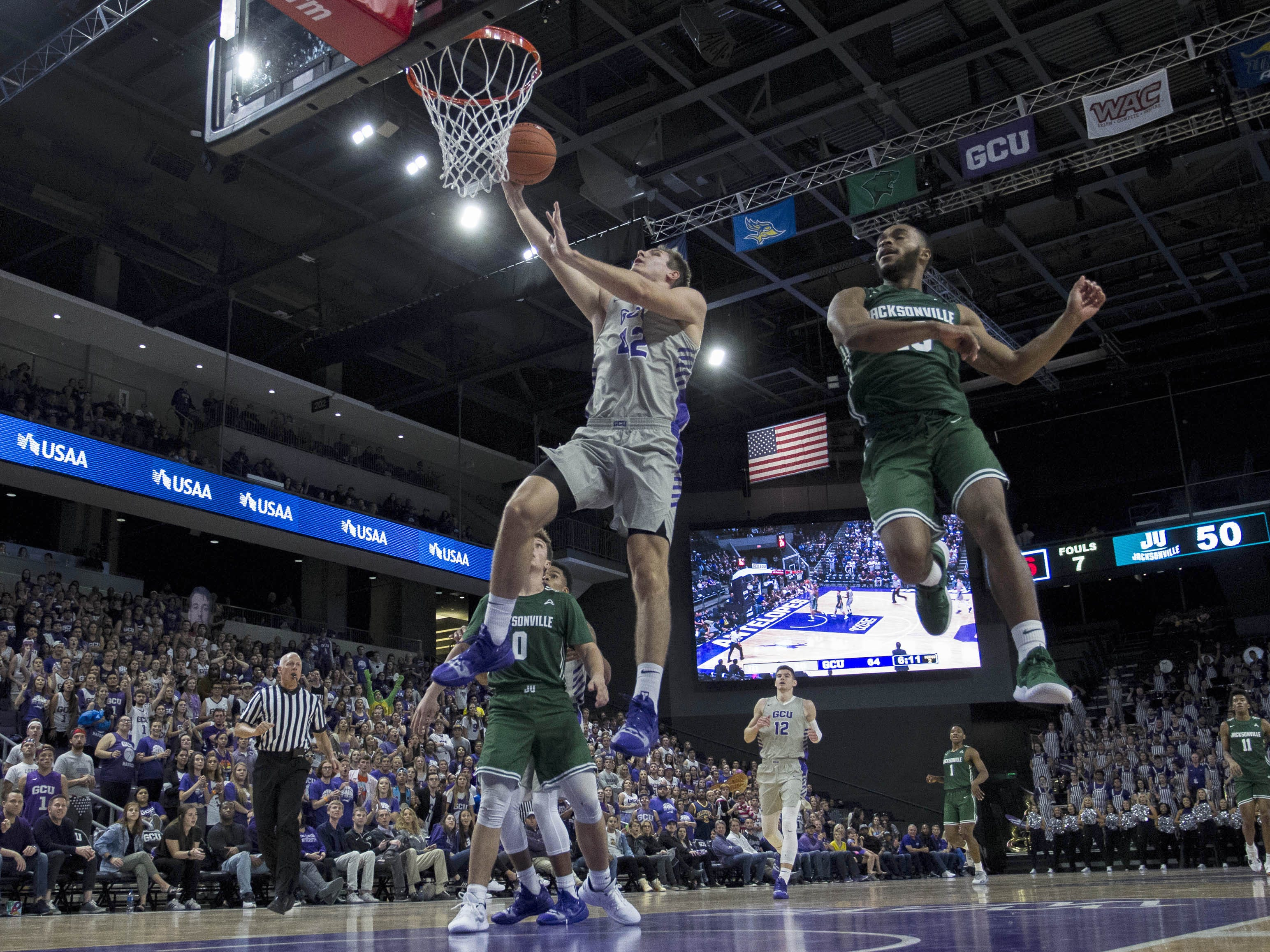 Grand Canyon University's Gerard Martin takes it to the basket against Jacksonville the second half of their game in Phoenix, Monday, Nov.11,  2018.