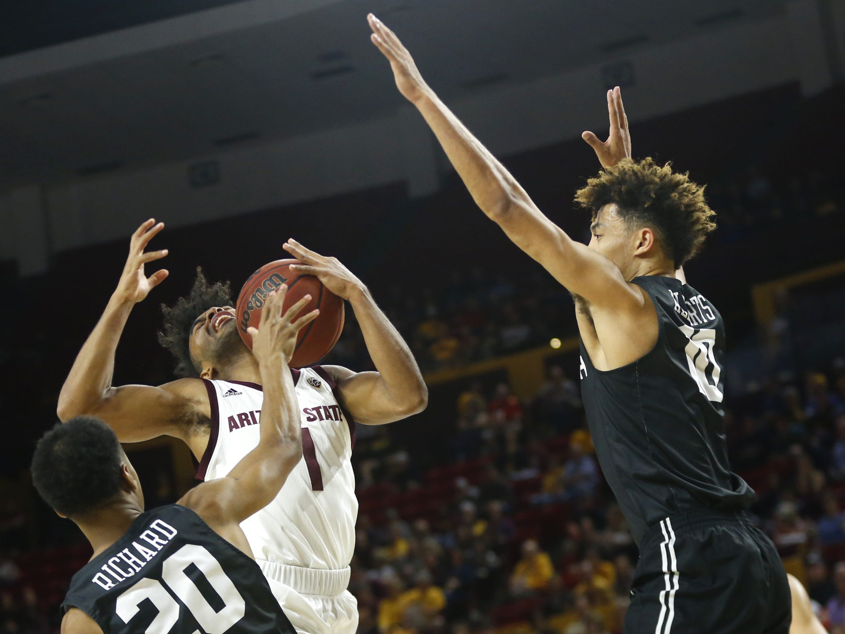 Arizona State's Remy Martin (1) draws a shooting foul on Long Beach State's Breamon Richard (20) during the first half at Wells Fargo Arena in Tempe, Ariz. on November 12, 2018.