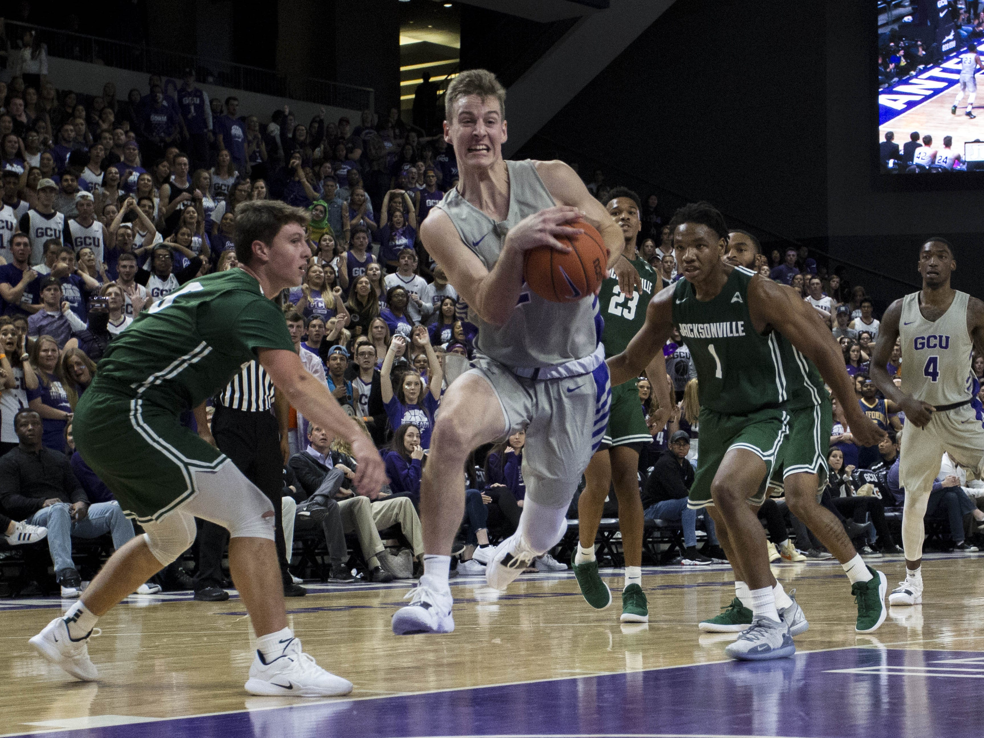 Grand Canyon University's Trey Drechsel takes it to the basket against Jacksonville the second half of their game in Phoenix, Monday, Nov.11,  2018.