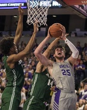 Grand Canyon University's Alessandro Lever (25) gets fouled by Jacksonville's Jace Hogan (14) as he drives to the basket during the first half of their game in Phoenix, Monday, Nov.11,  2018.