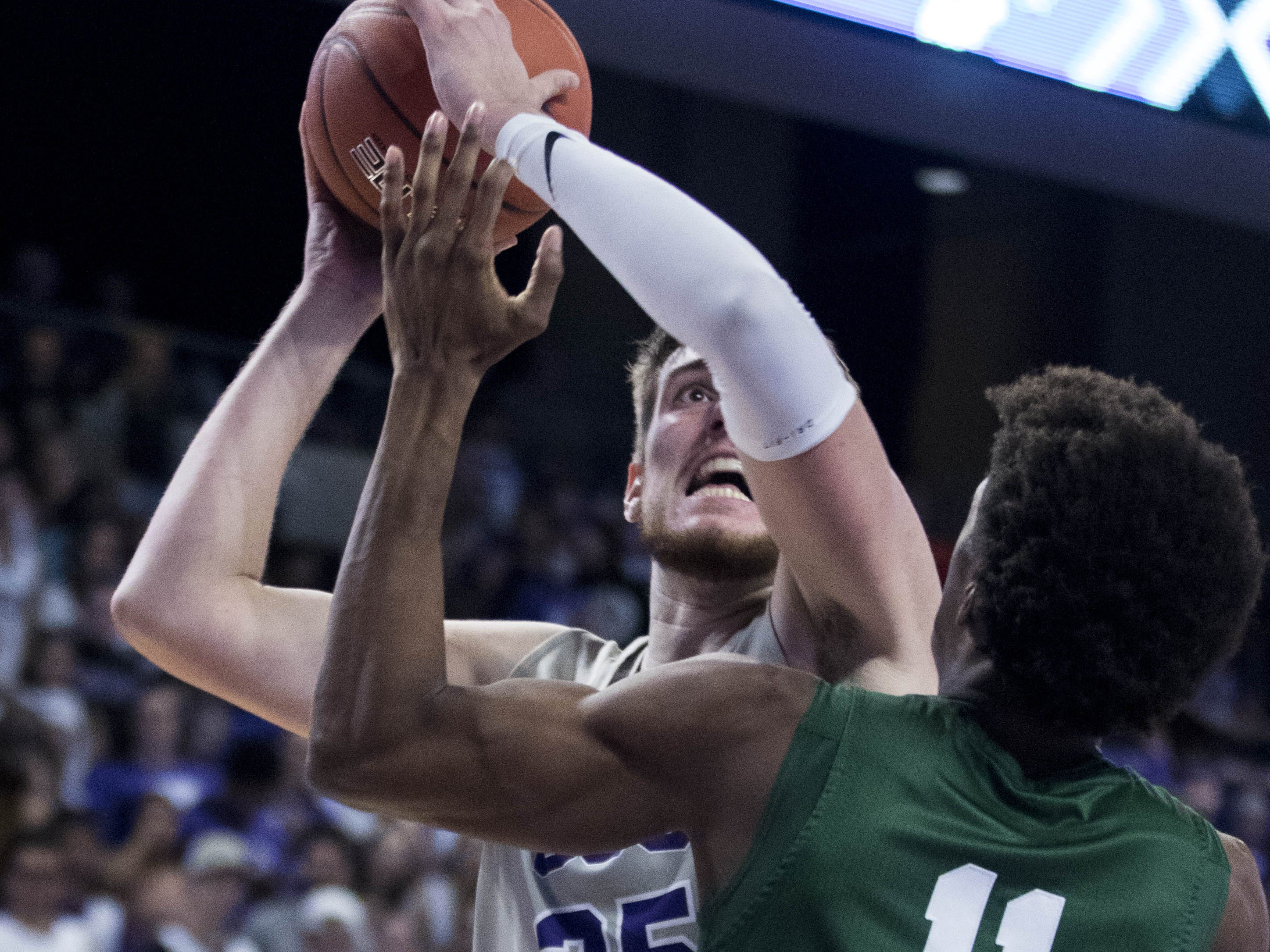 Grand Canyon University's Alessandro Lever looks to the basket against Jacksonville's Jalyn Hinton the second half of their game in Phoenix, Monday, Nov. 11, 2018.