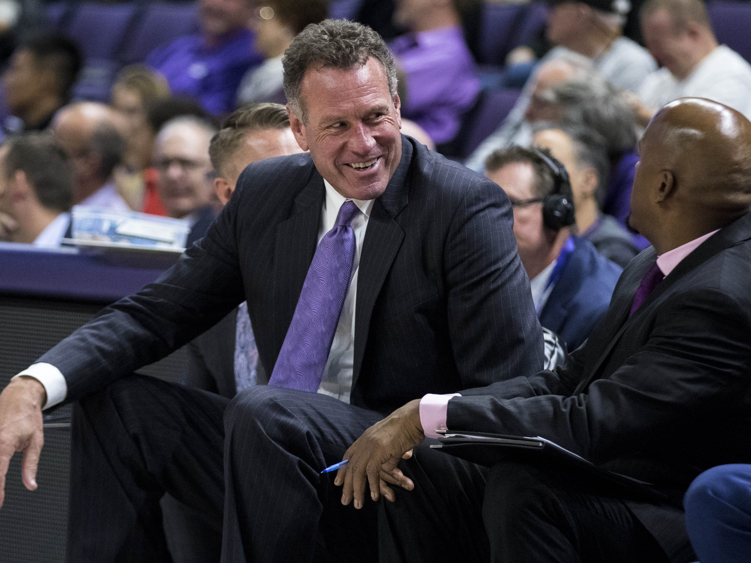 Grand Canyon University head coach Dan Majerle share a laugh with his assistant coach Louis Wilson during the second half of their game in Phoenix, Monday, Nov. 11, 2018.