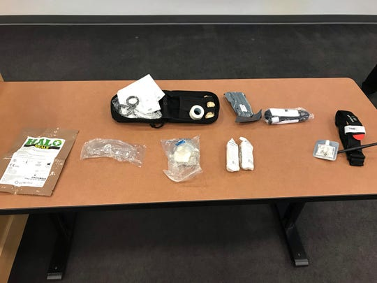 Surgical tape, gauze and a tourniquet are some of the first-aid supplies all Glendale police officers carry with them.