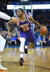 Phoenix Suns forward Mikal Bridges (25) pushes down the court in the first half of an NBA basketball game against the Oklahoma City Thunder in Oklahoma City, Monday, Nov. 12, 2018. (AP Photo/Kyle Phillips)