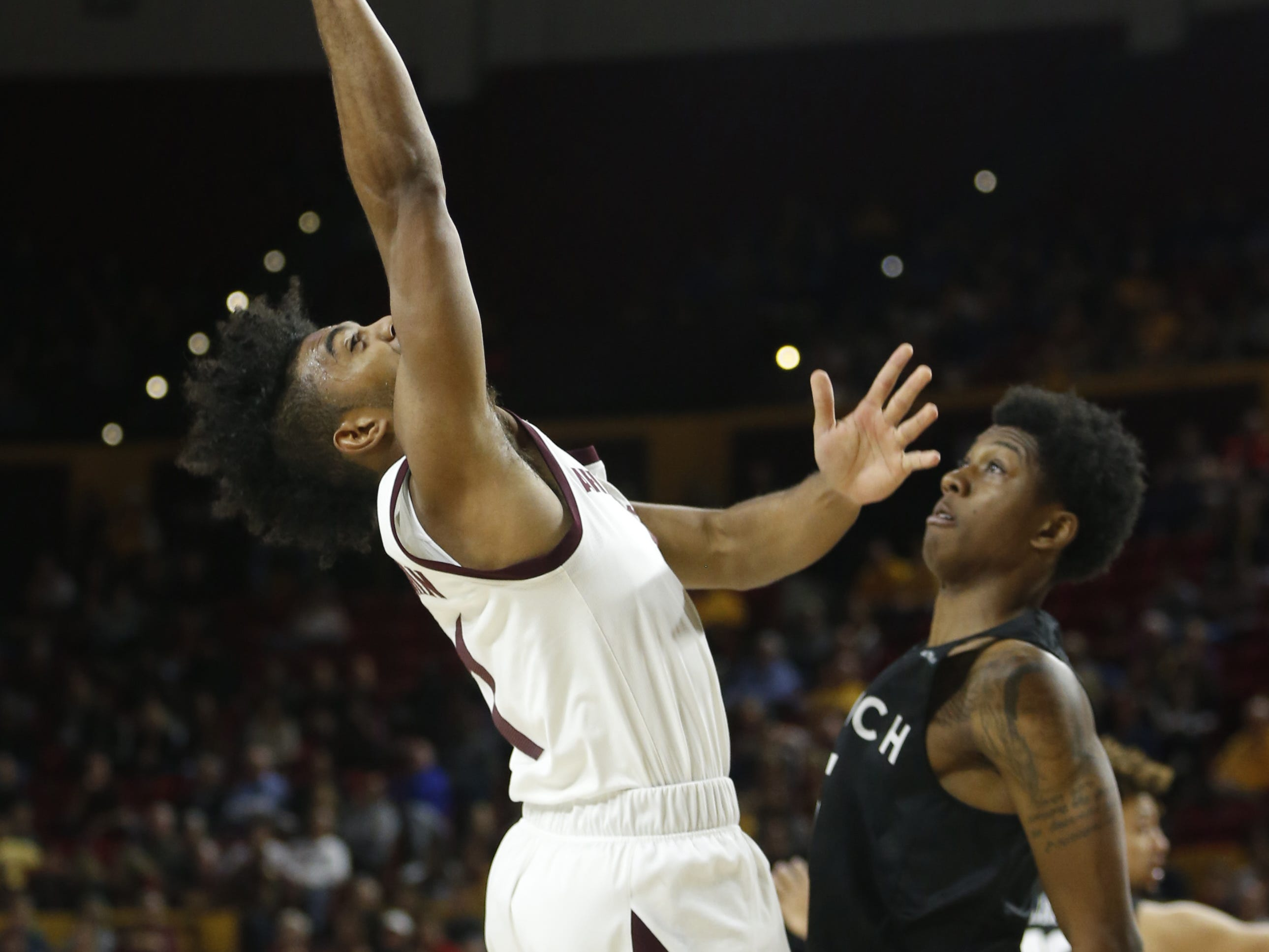 Arizona State's Remy Martin (1) goes up for a layup past Long Beach State's Deishuan Booker (15) during the first half at Wells Fargo Arena in Tempe, Ariz. on November 12, 2018.