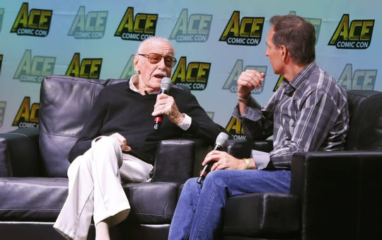 Comic legend Stan Lee speaks with Todd McFarlane during a discussion during Ace Comic Con at Gila River Arena on January 13, 2018 in Glendale, Ariz.