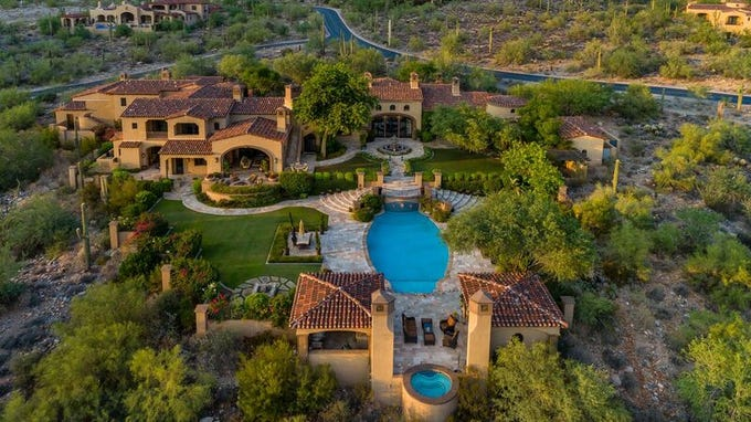 This Scottsdale mansion in the Silverleaf community includes a separate guest house with full kitchen, two private courtyards and a garage capable of holding eleven cars comfortably complete with lifts.