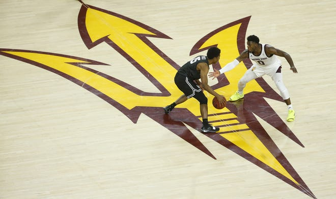 Arizona State's Luguentz Dort (0) defends Long Beach State's Deishuan Booker (15) during the second half against Long Beach State at Wells Fargo Arena in Tempe, Ariz. on November 12, 2018.
