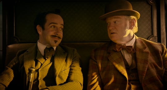 "The Englishman (Jonjo O'Neill, left) and the Irishman (Brendan Gleeson) travel in ""The Ballad of Buster Scruggs."""