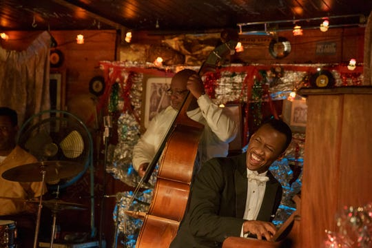"Dr. Donald Shirley (Mahershala Ali, right) gives an impromptu performance in ""Green Book."""