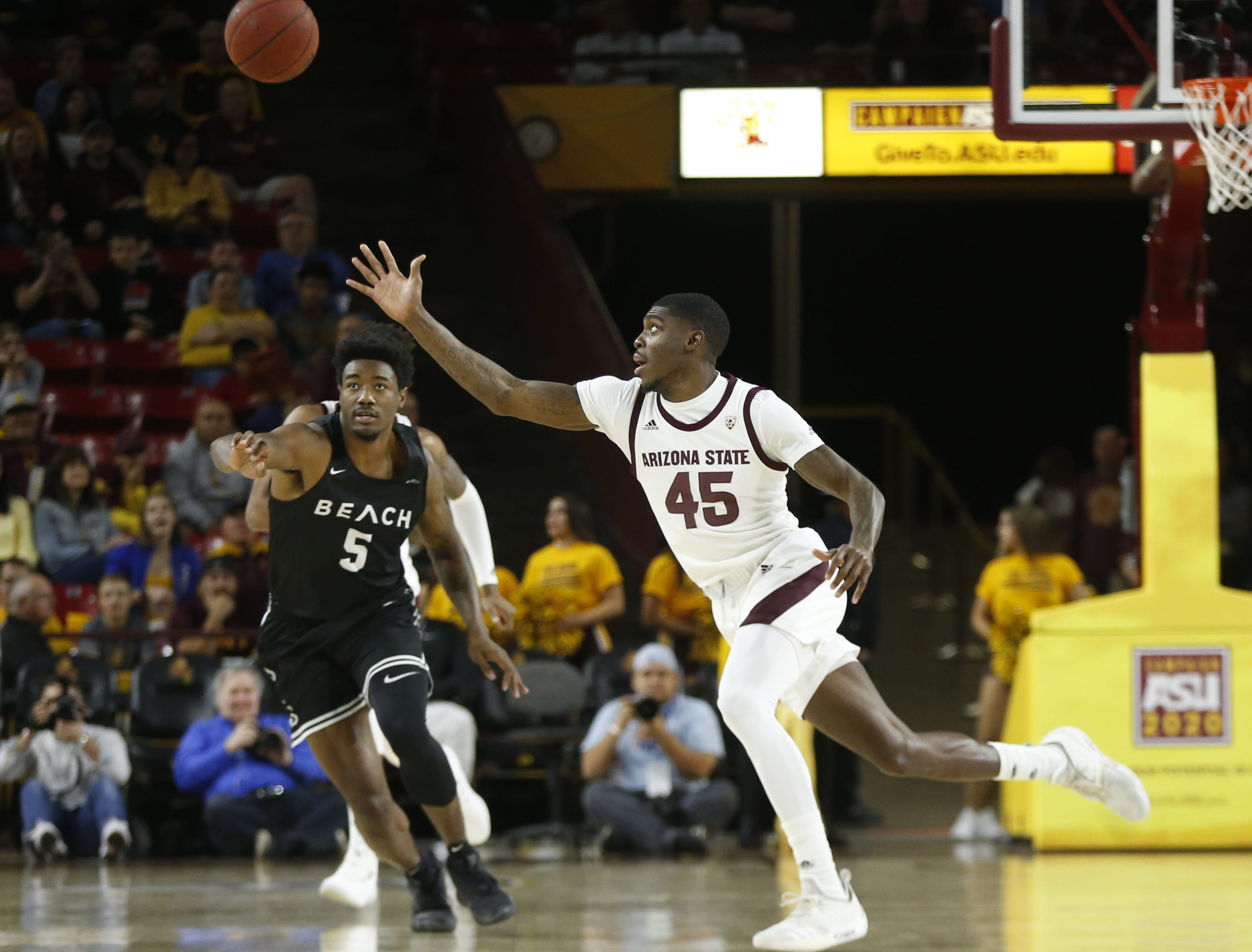 Arizona State's Zylan Cheatham (45) and Long Beach State's Mason Riggins (5) chase down a loose ball during the first half at Wells Fargo Arena in Tempe, Ariz. on November 12, 2018.