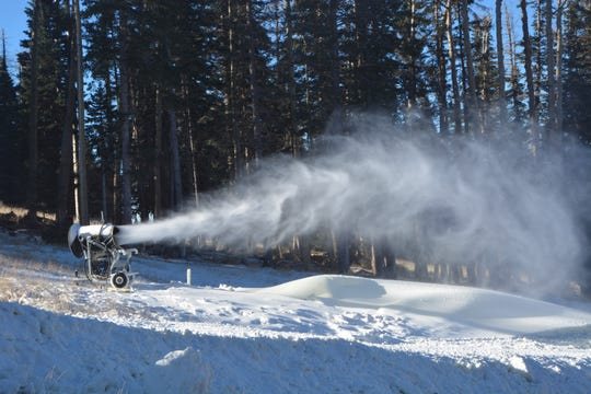 Snowmaking efforts are shown at Arizona Snowbowl.