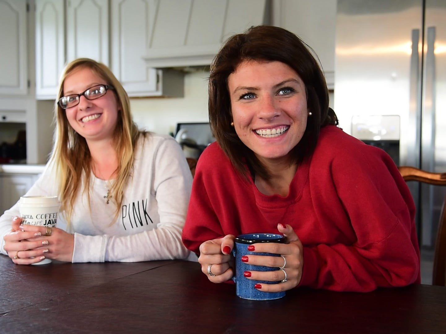 "Recovering heroin addict Alexandria Lowery, left, and recovering meth addict Ashley Ammerman, said their housemates are becoming the sisters they never had. ""They help you get through that bad time, because they know you are worth it and stronger than that,"" Ashley said. ""They love you when you can't love yourself."""