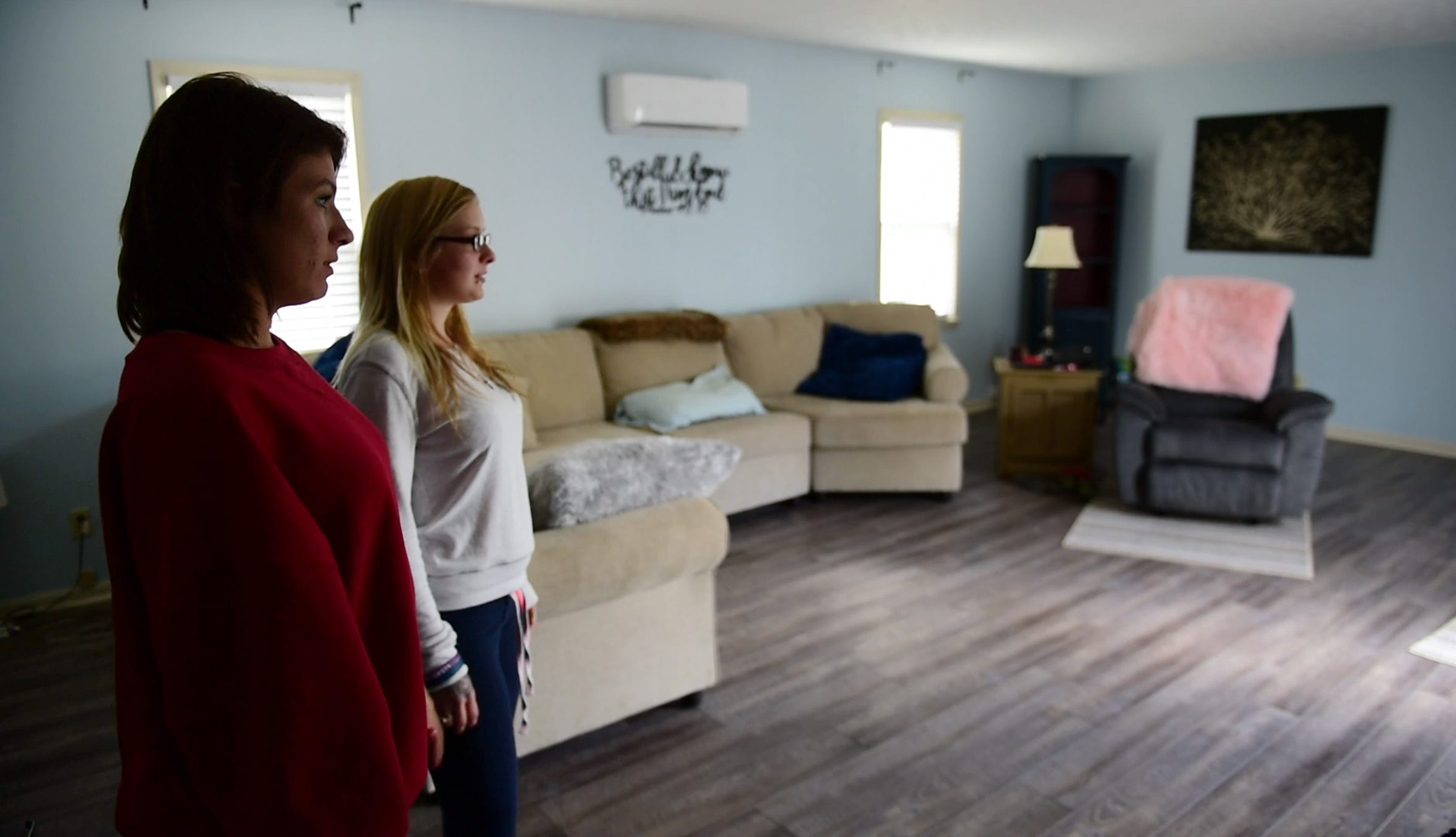 Recovering meth addict Ashley Ammerman, 23, left, and  recovering heroin addict Alexandria Lowery, 26, said they do chores around the house to keep their minds occupied and off off drugs. Residents are encouraged to attend counseling and meetings, meet others in recovery and get a job.