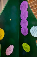 Paper ornaments with kids' names and wish lists hang on a fake tree at Port Huron Parks and Rec.