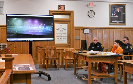 Nicole Addimando sits at the defense table while footage of her Sept. 28, 2017 interaction with Town of Poughkeepsie police officer Richard Sisilli is shown in Dutchess County Court on Nov. 13, 2018, during a pretrial hearing.