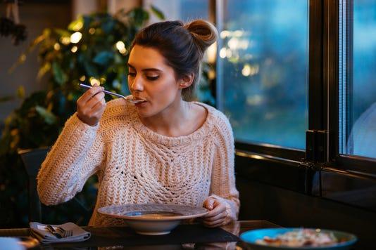 Beautiful Girl Having Dinner At Cafe