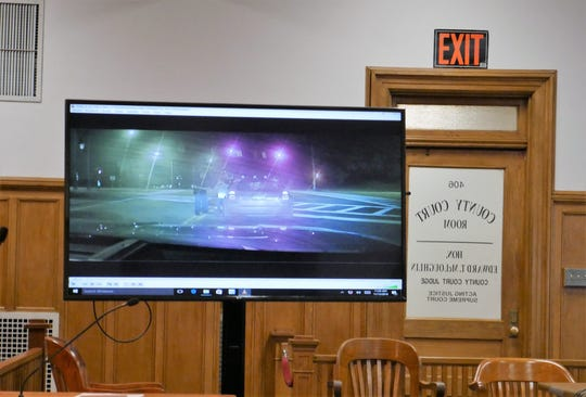 Video footage of Town of Poughkeepsie police officer Richard Sisilli's interaction with Nicole Addimando on Sept. 28, 2017, is shown in Dutchess County Court on Nov. 13, 2018, during a pretrial hearing.