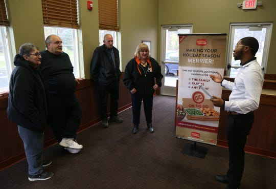 First on line at Golden Corral in the Town of Poughkeepsie on their opening day, from left Jo Anne & Frank Balestrie of Highland, Larry Curry and Dolly Matula of the Town of Poughkeepsie speaking with managing partner Lerone Jones on November 13, 2018.