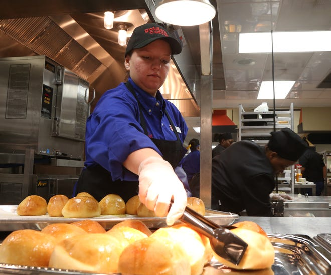 Morgan Atha brings out fresh baked rolls before opening to the public at Golden Corral in the Town of Poughkeepsie on November 13, 2018. Atha, an Idaho native is part of Golden Corral's A-Team and travels to new locations to help train staff.