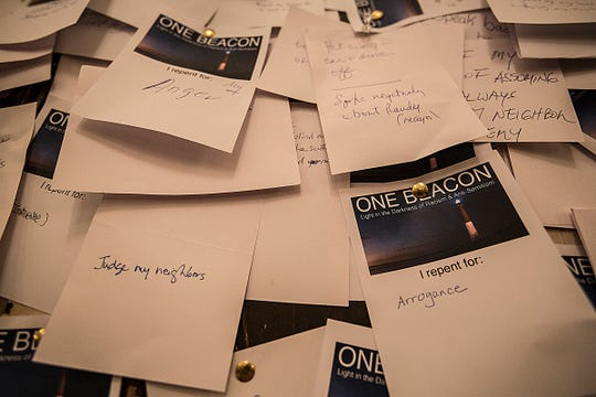 Attendees of the Nov. 1 Beacon One event posted notes listing ways to repent to make themselves and their community as a whole a better place.