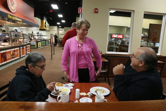 Manager Nanci Sanfilippo speaks with Jo Anne and Frank Balestrie as they finish their breakfast at Golden Corral in the Town of Poughkeepsie on November 13, 2018.
