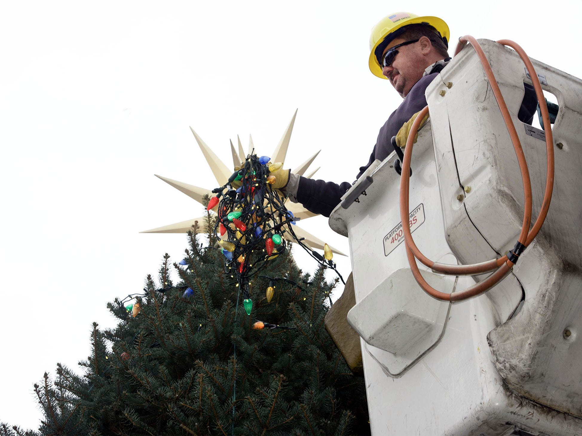 Borough of Chambersburg lineman Rob Roberts trims the Christmas tree at Memorial Square on Tuesday, November 13, 2018. This year's tree was donated by Darlene Fowler of Fayetteville.