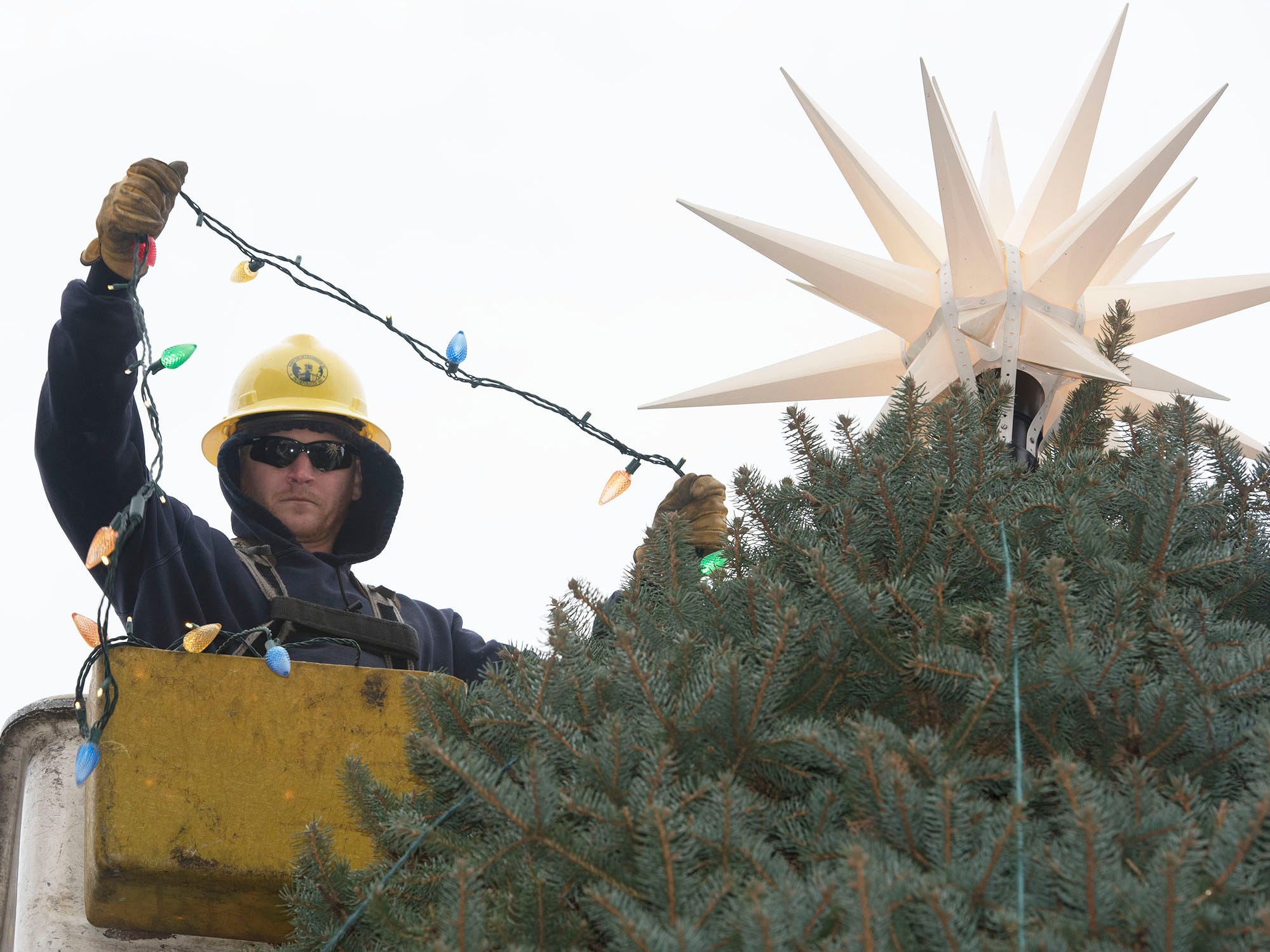 Borough of Chambersburg lineman Josh Swartz trims the Christmas tree at Memorial Square on Tuesday, November 13, 2018. This year's tree was donated by Darlene Fowler of Fayetteville.